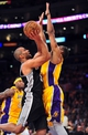 April 26, 2013; Los Angeles, CA, USA; San Antonio Spurs point guard Tony Parker (9) moves to the basket against the Los Angeles Lakers during the second half in game three of the first round of the 2013 NBA playoffs at Staples Center. Mandatory Credit: Gary A. Vasquez-USA TODAY Sports