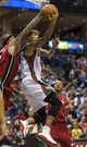 Apr 28, 2013; Milwaukee, WI, USA; Milwaukee Bucks guard Monta Ellis (11) drives for a reverse layup as Miami Heat forward Chris Andersen (11) defends during the third quarter of game four of the first round of the 2013 NBA playoffs at the BMO Harris Bradley Center.  Miami won 88-77.  Mandatory Credit: Jeff Hanisch-USA TODAY Sports