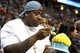 Apr 30, 2013; Denver, CO, USA; Denver Broncos defensive tackle Kevin Vickerson eats a birthday cake in the fourth quarter during game five of the first round of the 2013 NBA Playoffs between the Golden State Warriors and Denver Nuggets at the Pepsi Center. The Nuggets won 107-100. Mandatory Credit: Isaiah J. Downing-USA TODAY Sports