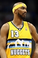 Apr 23, 2013; Denver, CO, USA; Denver Nuggets small forward Corey Brewer (13) during a stoppage of play in the third quarter against the Golden State Warriors during game two in the first round of the 2013 NBA playoffs at the Pepsi Center. The Warriors won 131-117. Mandatory Credit: Isaiah J. Downing-USA TODAY Sports