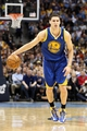 Apr 23, 2013; Denver, CO, USA; Golden State Warriors shooting guard Klay Thompson (11) controls the ball in the first quarter against the Denver Nuggets during game two in the first round of the 2013 NBA playoffs at the Pepsi Center. The Warriors won 131-117. Mandatory Credit: Isaiah J. Downing-USA TODAY Sports