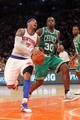 May 1, 2013; New York, NY, USA; New York Knicks forward Carmelo Anthony (7) drives on Boston Celtics forward Brandon Bass (30) during the fourth quarter of game five of the first round of the 2013 NBA Playoffs at Madison Square Garden. Mandatory Credit: Brad Penner-USA TODAY Sports