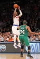 May 1, 2013; New York, NY, USA; New York Knicks guard J.R. Smith (8) shoots over Boston Celtics forward Paul Pierce (34) during the fourth quarter of game five of the first round of the 2013 NBA Playoffs at Madison Square Garden. Mandatory Credit: Brad Penner-USA TODAY Sports