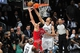May 4, 2013; Brooklyn, NY, USA; Chicago Bulls center Joakim Noah (13) puts up a shot over Brooklyn Nets center Brook Lopez (11) during the second half in game seven of the first round of the 2013 NBA Playoffs at the Barclays Center. The Bulls won 99-93. Mandatory Credit: Joe Camporeale-USA TODAY Sports