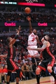 May 10, 2013; Chicago, IL, USA; Chicago Bulls point guard Nate Robinson (center) shoots over Miami Heat center Chris Bosh (left) and Miami Heat power forward Chris Andersen (right) during the second half in game three of the second round of the 2013 NBA Playoffs at the United Center. Miami won 104-94. Mandatory Credit: Dennis Wierzbicki-USA TODAY Sports