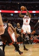 May 13, 2013; Chicago, IL, USA;  Chicago Bulls point guard Nate Robinson (2) shoots the ball against Miami Heat power forward Udonis Haslem (40) during the second half at the United Center. Miami defeats Chicago 88-65. Mandatory Credit: Mike DiNovo-USA TODAY Sports