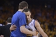 May 16, 2013; Oakland, CA, USA; Golden State Warriors point guard Stephen Curry (30, right) receives a hug from power forward David Lee (left) after leaving the game during the fourth quarter in game six of the second round of the 2013 NBA Playoffs against the San Antonio Spurs at Oracle Arena. The Spurs defeated the Warriors 94-82.  Mandatory Credit: Kyle Terada-USA TODAY Sports