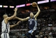 May 19, 2013; San Antonio, TX, USA; Memphis Grizzlies small forward Tayshaun Prince (21, right) controls the ball during the third quarter as San Antonio Spurs power forward Tim Duncan (21, left) defends in game one of the Western Conference finals of the 2013 NBA Playoffs at AT&T Center. Mandatory Credit: Troy Taormina-USA TODAY Sports
