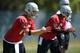 May 20, 2013; Alameda, CA, USA; Oakland Raiders quarterbacks Matt Flynn (15) and Terrelle Pryor (6) prepare to take the snap at organized team activities at the Raiders practice facility. Mandatory Credit: Kirby Lee-USA TODAY Sports