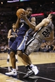 May 21, 2013; San Antonio, TX, USA; San Antonio Spurs guard Manu Ginobili (20) draws a charge from Memphis Grizzlies guard Tony Allen (9) in game two of the Western Conference finals of the 2013 NBA Playoffs at AT&T Center. Mandatory Credit: Soobum Im-USA TODAY Sports