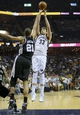 May 25, 2013; Memphis, TN, USA; Memphis Grizzlies center Marc Gasol (33) shoots the ball over San Antonio Spurs power forward Tim Duncan (21) in game three of the Western Conference finals of the 2013 NBA Playoffs at FedEx Forum. San Antonio Spurs defeat the Memphis Grizzlies 104-93, and lead the series 3-0.  Mandatory Credit: Spruce Derden-USA TODAY Sports