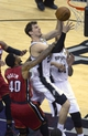 Jun 11, 2013; San Antonio, TX, USA; San Antonio Spurs center Tiago Splitter (22) drives to the basket past Miami Heat power forward Udonis Haslem (40) in the third quarter during game three of he 2013 NBA Finals at the AT&T Center. Mandatory Credit: Brendan Maloney-USA TODAY Sports
