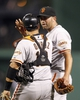 Jun 13, 2013; Pittsburgh, PA, USA; San Francisco Giants catcher Guillermo Quiroz (12) and relief pitcher Jeremy Affeldt (right) celebrate after defeating the Pittsburgh Pirates at PNC Park. The San Francisco Giants won 10-0. Mandatory Credit: Charles LeClaire-USA TODAY Sports