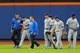 Jun 14, 2013; New York, NY, USA; Chicago Cubs center fielder David DeJesus (9) walks off the field after running into the wall chasing a triple by New York Mets center fielder Juan Lagares (not pictured) during the third inning of a game at Citi Field. Mandatory Credit: Brad Penner-USA TODAY Sports