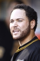 Jun 14, 2013; Pittsburgh, PA, USA; Pittsburgh Pirates catcher Russell Martin (55) reacts in the dugout against the Los Angeles Dodgers during the third inning at PNC Park. Mandatory Credit: Charles LeClaire-USA TODAY Sports