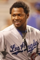 Jun 14, 2013; Pittsburgh, PA, USA; Los Angeles Dodgers shortstop Hanley Ramirez (13) reacts in the dugout against the Pittsburgh Pirates during the eighth inning at PNC Park. The Pittsburgh Pirates won 3-0. Mandatory Credit: Charles LeClaire-USA TODAY Sports