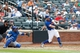 Jun 16, 2013; Flushing, NY,USA; New York Mets third baseman David Wright (5) flies out to left advancing two men during the sixth inning against the Chicago Cubs at Citi Field.  Mandatory Credit: Anthony Gruppuso-USA TODAY Sports