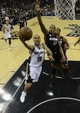 Jun 16, 2013; San Antonio, TX, USA;  San Antonio Spurs point guard Tony Parker (9) drives to the basket past Miami Heat point guard Mario Chalmers (15) during the fourth quarter of game five in the 2013 NBA Finals at the AT&T Center. Mandatory Credit: Brendan Maloney-USA TODAY Sports