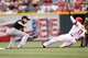 Jun 17, 2013; Cincinnati, OH, USA; Pittsburgh Pirates shortstop Jordy Mercer (10) tags out Cincinnati Reds center fielder Shin-Soo Choo (17) trying to steal during the first inning at Great American Ball Park. Mandatory Credit: Frank Victores-USA TODAY Sports