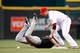 Jun 17, 2013; Cincinnati, OH, USA; Cincinnati Reds shortstop Zack Cozart (2) misses the tag on Pittsburgh Pirates shortstop Jordy Mercer (10) during the third inning at Great American Ball Park. Mandatory Credit: Frank Victores-USA TODAY Sports