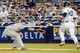 Jun 21, 2013; Bronx, NY, USA; New York Yankees third baseman David Adams (39) reaches first on an infield single as Tampa Bay Rays first baseman James Loney (21) misses the ball during the fourth inning at Yankee Stadium.  Mandatory Credit: Anthony Gruppuso-USA TODAY Sports