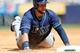 Jun 23, 2013; Bronx, NY, USA;  Tampa Bay Rays first baseman James Loney (21) slides to third during the sixth inning against the New York Yankees at Yankee Stadium.  Mandatory Credit: Anthony Gruppuso-USA TODAY Sports