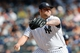 Jun 23, 2013; Bronx, NY, USA;  New York Yankees relief pitcher Joba Chamberlain (62) pitches during the seventh inning against the Tampa Bay Rays at Yankee Stadium.  Tampa won 3-1.  Mandatory Credit: Anthony Gruppuso-USA TODAY Sports