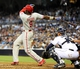 June 25, 2013; San Diego, CA, USA; Philadelphia Phillies left fielder Domonic Brown (9) hits a three-run home run during the third inning against the San Diego Padres at Petco Park. Mandatory Credit: Christopher Hanewinckel-USA TODAY Sports