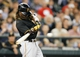 Jun 25, 2013; Seattle, WA, USA; Pittsburgh Pirates center fielder Andrew McCutchen (22) singles against the Seattle Mariners during the sixth inning at Safeco Field. Mandatory Credit: Joe Nicholson-USA TODAY Sports