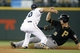 Jun 26, 2013; Seattle, WA, USA; Pittsburgh Pirates shortstop Jordy Mercer (10) is tagged out on a steal attempt against Seattle Mariners second baseman Nick Franklin (20) during the seventh inning at Safeco Field. Pittsburgh defeated Seattle, 4-2. Mandatory Credit: Joe Nicholson-USA TODAY Sports
