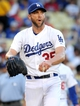 Jun 28, 2013; Los Angeles, CA, USA;  Los Angeles Dodgers starting pitcher Chris Capuano (35) reacts to allowing a run to score in the first inning of the game against the Philadelphia Phillies at Dodger Stadium. Mandatory Credit: Jayne Kamin-Oncea-USA TODAY Sports
