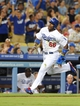 Jun 28, 2013; Los Angeles, CA, USA;  Los Angeles Dodgers right fielder Yasiel Puig (66) scores a run in the sixth inning of the game against the Philadelphia Phillies at Dodger Stadium. Mandatory Credit: Jayne Kamin-Oncea-USA TODAY Sports