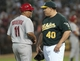 Jun 28, 2013; Oakland, CA, USA; St. Louis Cardinals third base coach Jose Oquendo (11) and Oakland Athletics starting pitcher Bartolo Colon (40) talk between innings at O.Co Coliseum. Mandatory Credit: Ed Szczepanski-USA TODAY Sports