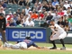 Jun 29, 2013; Chicago, IL, USA; Cleveland Indians left fielder Michael Brantley (23) dives safely under the tag of Chicago White Sox first baseman Jeff Keppinger (7) during the second inning at US Cellular Field. Mandatory Credit: Dennis Wierzbicki-USA TODAY Sports