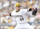 Jun 30, 2013; Pittsburgh, PA, USA; Pittsburgh Pirates starting pitcher Charlie Morton (50) throws a pitch against the Milwaukee Brewers during the second inning at PNC Park. Mandatory Credit: Charles LeClaire-USA TODAY Sports