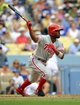 June 30, 2013; Los Angeles, CA, USA; Philadelphia Phillies shortstop Jimmy Rollins (11) hits a single during the seventh inning against the Los Angeles Dodgers at Dodger Stadium. Mandatory Credit: Gary A. Vasquez-USA TODAY Sports