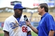 June 30, 2013; Los Angeles, CA, USA; Los Angeles Dodgers right fielder Yasiel Puig (66) is interviewed following the 6-1 victory against the Philadelphia Phillies at Dodger Stadium. Mandatory Credit: Gary A. Vasquez-USA TODAY Sports