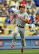 June 30, 2013; Los Angeles, CA, USA; Philadelphia Phillies second baseman Chase Utley (26) runs home to score a run in the ninth inning against the Los Angeles Dodgers at Dodger Stadium. Mandatory Credit: Gary A. Vasquez-USA TODAY Sports