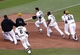 Jun 30, 2013; Pittsburgh, PA, USA; Pittsburgh Pirates pinch hitter Russell Martin (55) is chased by teammates after Martin hit a game winning RBI single against the Milwaukee Brewers during the fourteenth inning at PNC Park. The Pittsburgh Pirates won 2-1 in fourteen innings. Mandatory Credit: Charles LeClaire-USA TODAY Sports