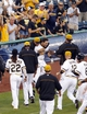Jun 30, 2013; Pittsburgh, PA, USA; Pittsburgh Pirates pinch hitter Russell Martin (center) is mobbed by teammates after Martin hit a game winning RBI single against the Milwaukee Brewers during the fourteenth inning at PNC Park. The Pittsburgh Pirates won 2-1 in fourteen innings. Mandatory Credit: Charles LeClaire-USA TODAY Sports