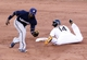 Jun 30, 2013; Pittsburgh, PA, USA; Pittsburgh Pirates first baseman Gaby Sanchez (14) steals second base as Milwaukee Brewers second baseman Rickie Weeks (left) takes a late throw during the fourteenth inning at PNC Park. The Pittsburgh Pirates won 2-1 in fourteen innings.  Mandatory Credit: Charles LeClaire-USA TODAY Sports