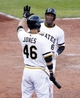 Jun 30, 2013; Pittsburgh, PA, USA; Pittsburgh Pirates left fielder Starling Marte (6) crosses home plate to score a run and is greeted by right fielder Garrett Jones (46) against the Milwaukee Brewers during the eighth inning at PNC Park. The Pittsburgh Pirates won 2-1 in fourteen innings. Mandatory Credit: Charles LeClaire-USA TODAY Sports