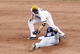 Jun 30, 2013; Pittsburgh, PA, USA; Pittsburgh Pirates second baseman Neil Walker (18) tags out Milwaukee Brewers shortstop Jean Segura (9) on a stolen base attempt during the fourteenth inning at PNC Park. The Pittsburgh Pirates won 2-1 in fourteen innings. Mandatory Credit: Charles LeClaire-USA TODAY Sports