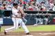 Jul 2, 2013; Atlanta, GA, USA; Atlanta Braves second baseman Dan Uggla (26) drives in a run in the second inning against the Miami Marlins at Turner Field. Mandatory Credit: Daniel Shirey-USA TODAY Sports