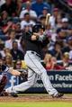 Jul 2, 2013; Atlanta, GA, USA; Miami Marlins pinch hitter Greg Dobbs (29) hits an RBI single in the sixth inning against the Atlanta Braves at Turner Field. Mandatory Credit: Daniel Shirey-USA TODAY Sports