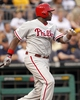 Jul 2, 2013; Pittsburgh, PA, USA; Philadelphia Phillies first baseman Ryan Howard (6) hits an RBI single against the Pittsburgh Pirates during the sixth inning at PNC Park. Mandatory Credit: Charles LeClaire-USA TODAY Sports