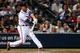 Jul 2, 2013; Atlanta, GA, USA; Atlanta Braves shortstop Andrelton Simmons (19) hits an RBI single in the sixth inning against the Miami Marlins at Turner Field. Mandatory Credit: Daniel Shirey-USA TODAY Sports