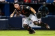 Jul 2, 2013; Atlanta, GA, USA; Miami Marlins catcher Rob Brantly (19) fields a ground ball for an out in the sixth inning against the Atlanta Braves at Turner Field. Mandatory Credit: Daniel Shirey-USA TODAY Sports
