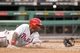 Jul 2, 2013; Pittsburgh, PA, USA; Philadelphia Phillies first baseman Ryan Howard (6) touches home plate to score a run against the Pittsburgh Pirates during the sixth inning at PNC Park. Mandatory Credit: Charles LeClaire-USA TODAY Sports
