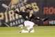 Jul 2, 2013; Pittsburgh, PA, USA; Pittsburgh Pirates left fielder Starling Marte (6) misses making a sliding catch in the outfield against the Philadelphia Phillies during the ninth inning at PNC Park. The Philadelphia Phillies won 3-1. Mandatory Credit: Charles LeClaire-USA TODAY Sports
